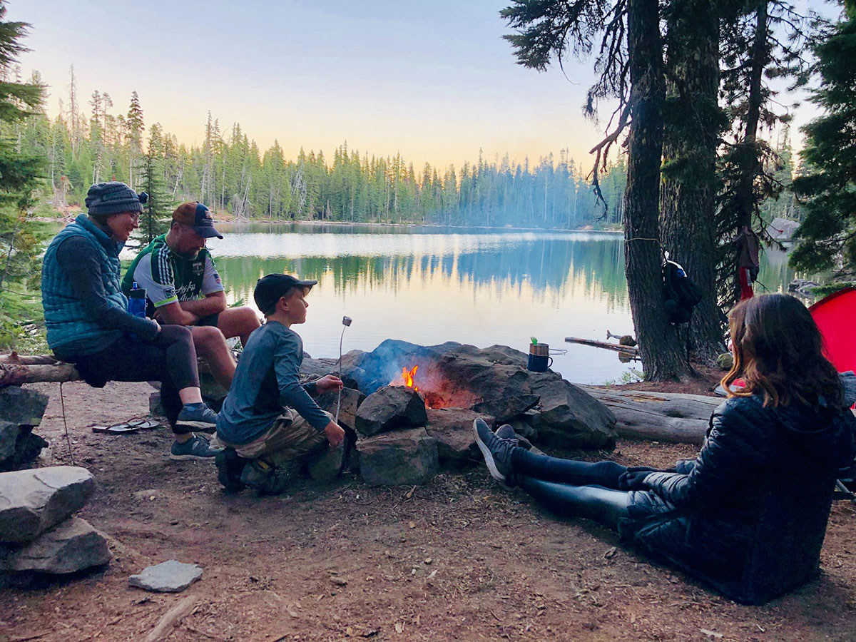 family out camping with campfire