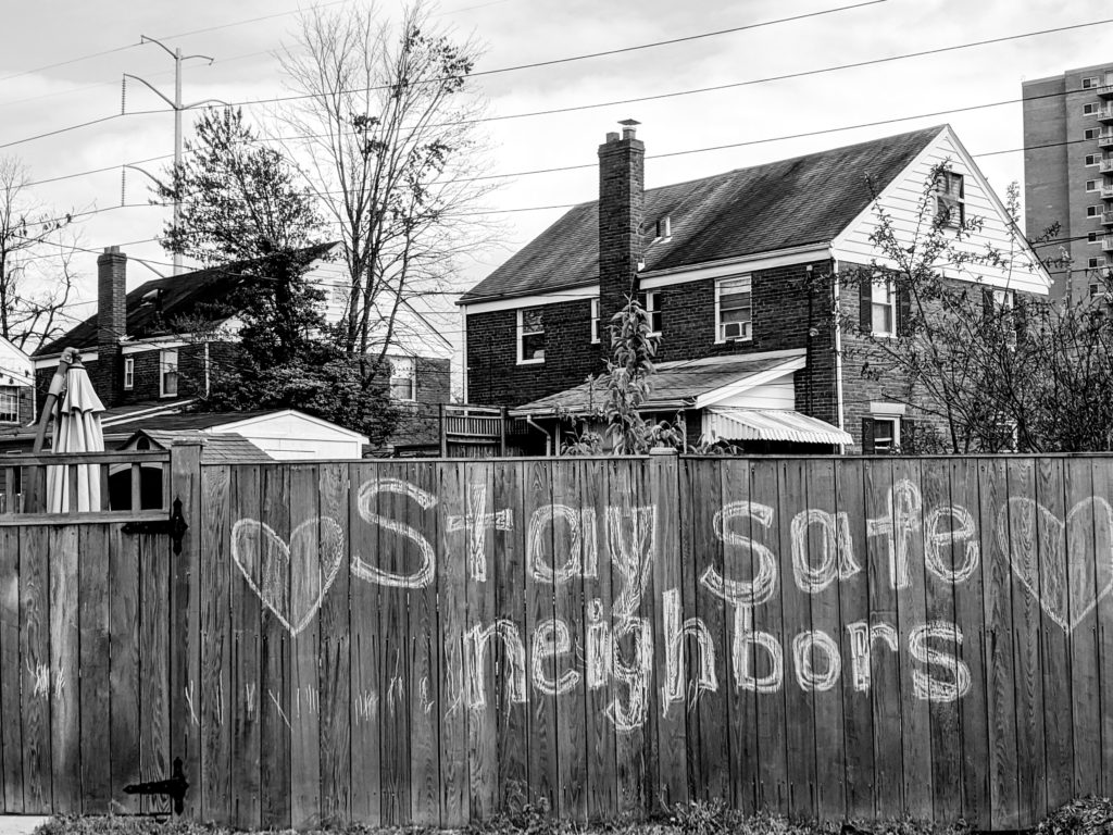 fence that says stay safe neighbors
